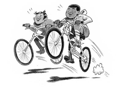 Brandon and Steven riding bikes in The Land without Color